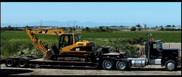 semi carrying excavator
